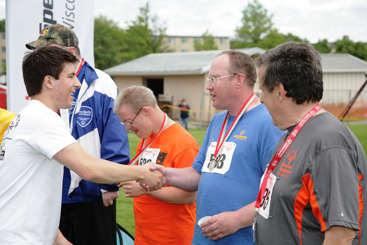 Photo of medal presentation and shaking hands