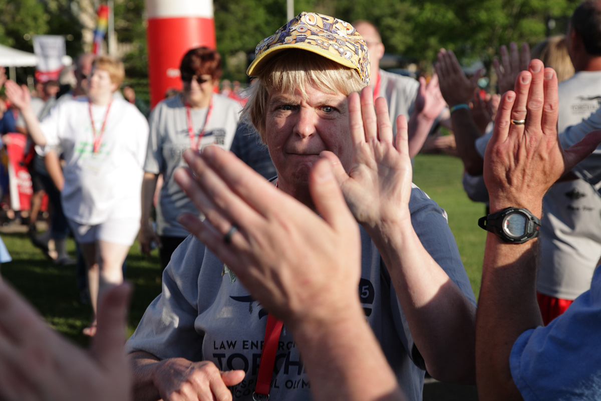 Photo of participants getting high fives from crowd