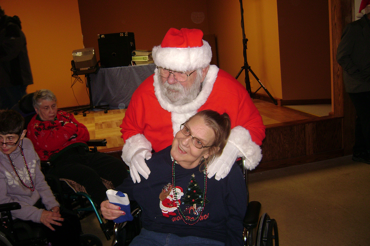 Photo from a Holiday party with a smiling santa