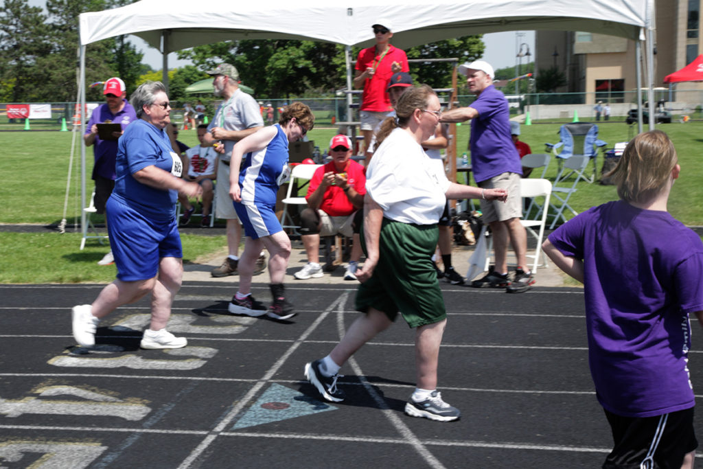 Photo of participants in a running event on track