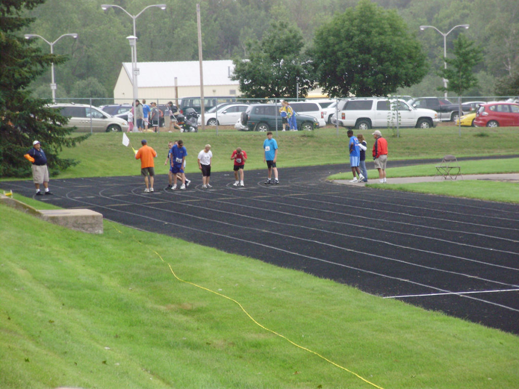 Photo of the start of a running event on track