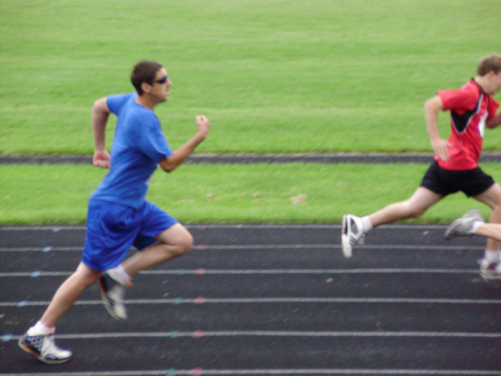 Photo of an athlete running on track